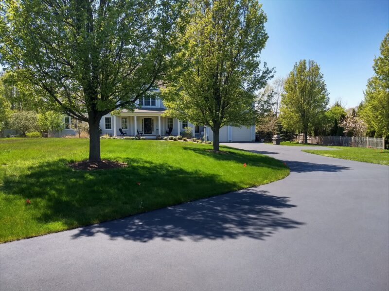 A beautiful driveway, beautiful yard, beautiful home.